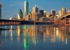 The Trinity River reflects the striking buildings that make Dallas one of the most renown skylines in the nation.