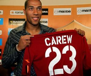 CAREW...Norway's John Carew shows his prospective soccer team Roma's jersey during his official presentation to the media at Roma's headquarters in Trigoria, in the outskirts of Rome, Thursday, Sept. 11, 2003. (AP Photo/Giuseppe Calzuola)...S...SOC...ROME...ITA