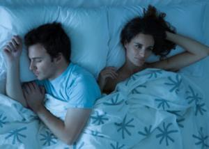 8499_woman-man-sleeping-getty